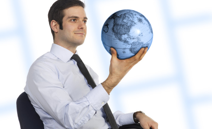 a man holding the globe