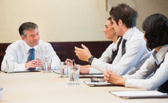 Smiling business people having a meeting in conference room