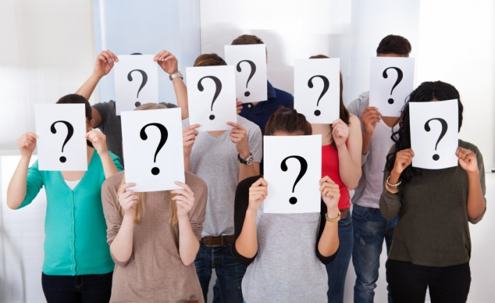 University-Students-Holding-Question-Mark-Signs-000048412282_Small