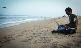 1024px-Yuvi_working_on_beach_1